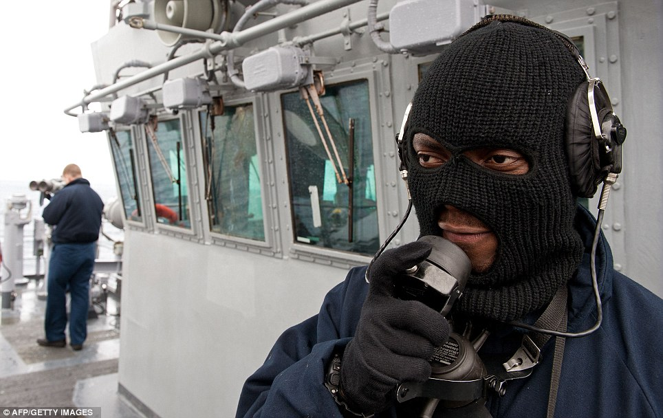 Forward look: Seaman Opoku calls out sightings on board the USS Wasp in the Atlantic Ocean