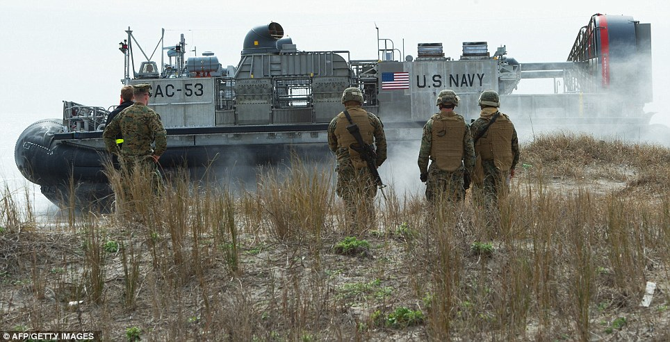 Drilled: An LCAC hovercraft goes back for another load of troops and equipment after making shore