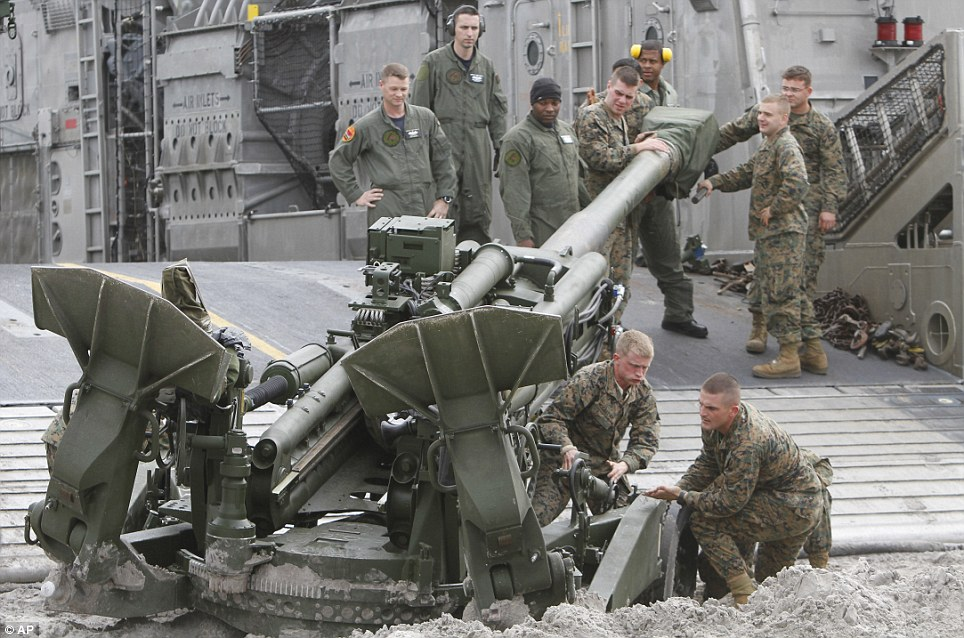 Storm: Marines help to move an artillery piece after landing on a beach near Camp Lejeune, North Carolina, during the Bold Alligator exercise