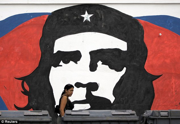 History: The prominent image of rebel revolutionary leader Che Guevara looks from a wall in Havana as the 50th anniversary of the embargo passes