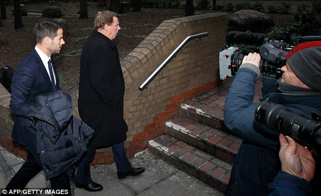 Nervous times: Redknapp was again joined by his son, Jamie (left), as the two-week case reached its climax