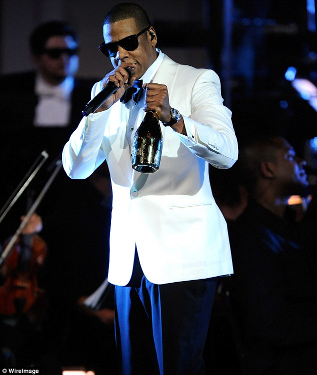 Host with the most: Jay-Z looked as fetching as his wife in this white blazer as he entertained the crowd