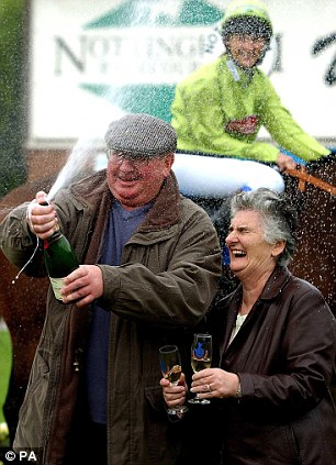 Celebrating: Michael and Jean O'Shea after winning £10,215,000 on the EuroMillions in October 2005