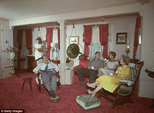 Refuge: Walt Disney sits with (clockwise from left) his daughter, Diane, an unidentified man, his daughter, Sharon, and wife, Lilly, while they read and drink from tea cups in their turn of the century apartment circa 1955
