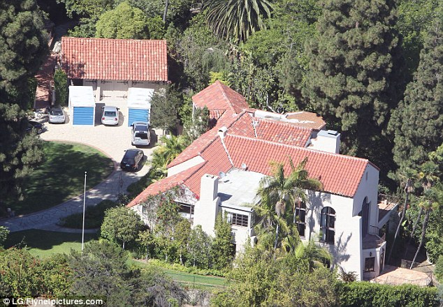 Moving on: The $6.5million  seven  bedroom Hollywood Hills mansion Russell and Katy bought together last summer