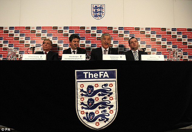 Address: Chairman of the FA David Bernstein (centre) speaks to the media at Wembley on Thursday