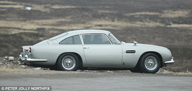 Vintage favourite: The traditional Aston Martin was seen back on the James Bond Skyfall set in Glencoe today
