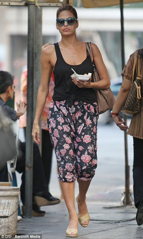 Missing someone? Eva Mendes looks a little glum as she wanders around Bangkok today, where her boyfriend Ryan Gosling is currently filming