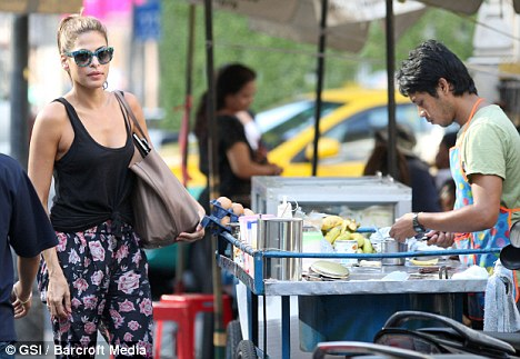 Tourist: The actress sampled local cuisine from food stalls