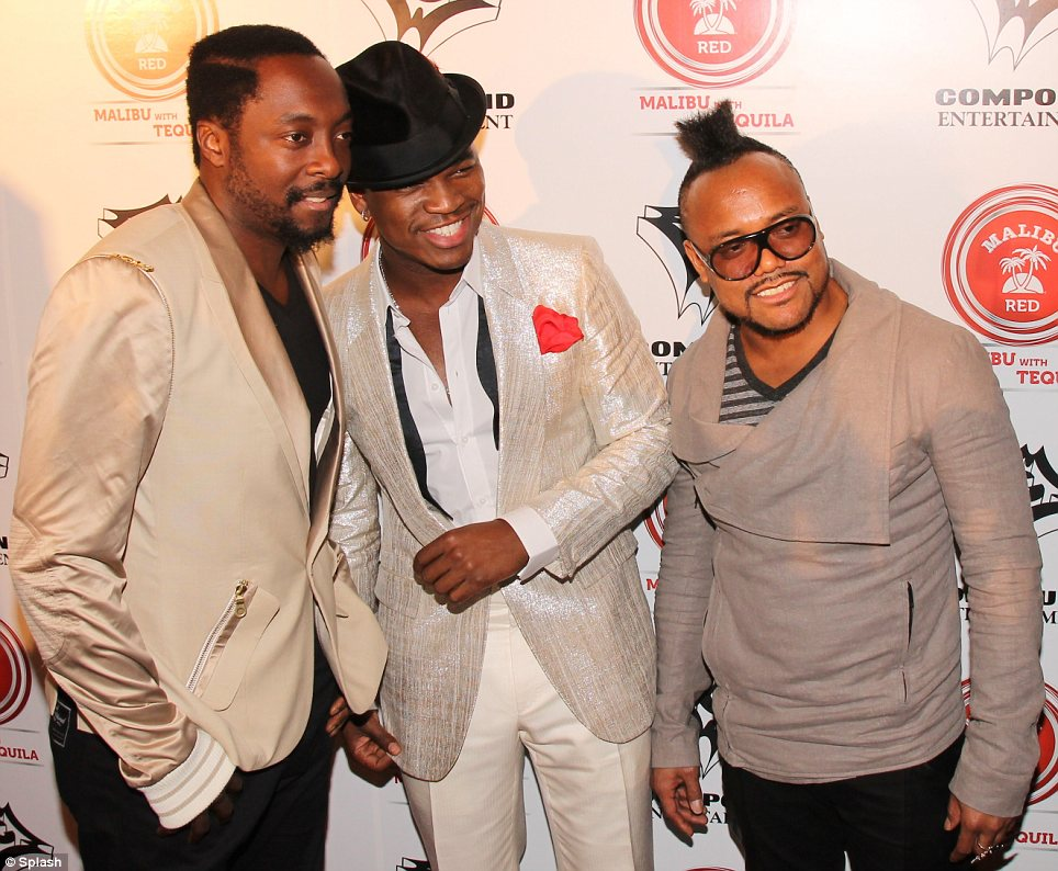 Tribute: Ne-Yo, pictured with Black Eyed Peas stars Will.I.Am (L) and Apl de Ap (R), honoured Whitney at his event and the guests were seen dancing and singing along to some of her classic hits, which blasted through the speakers