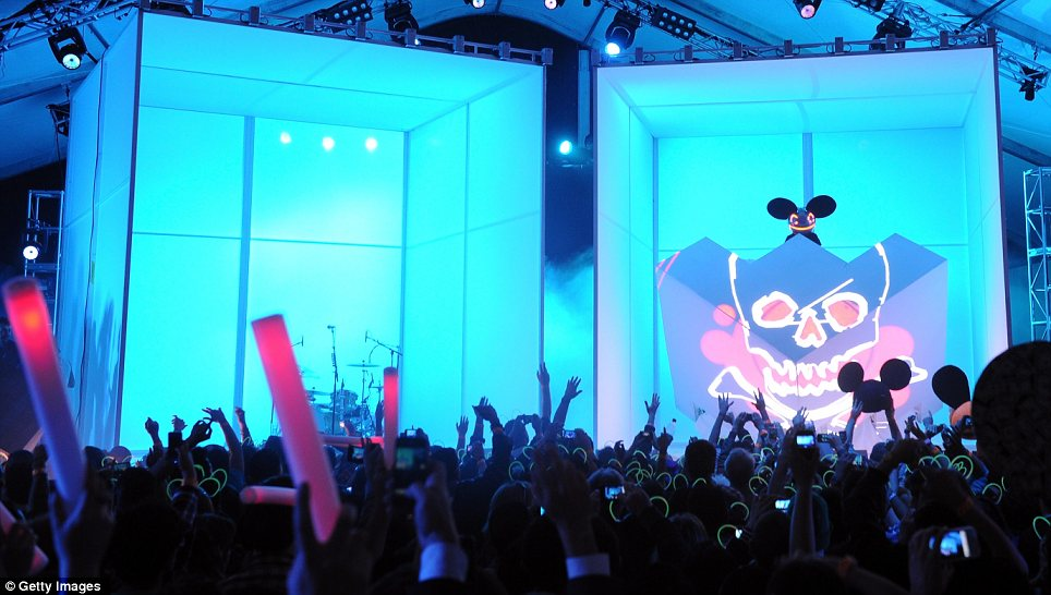 Excited fans: Deadmau5 came on stage surrounded by blue, while fans waved their hands in the air to the music