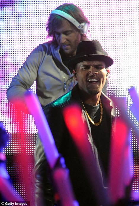 Working the crowd: David Guetta and Chris Brown also performed together at the awards ceremony to the delight of the audience