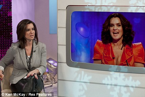 How low can you go? Katarina Witt discusses her revealing dresses during an appearance on This Morning