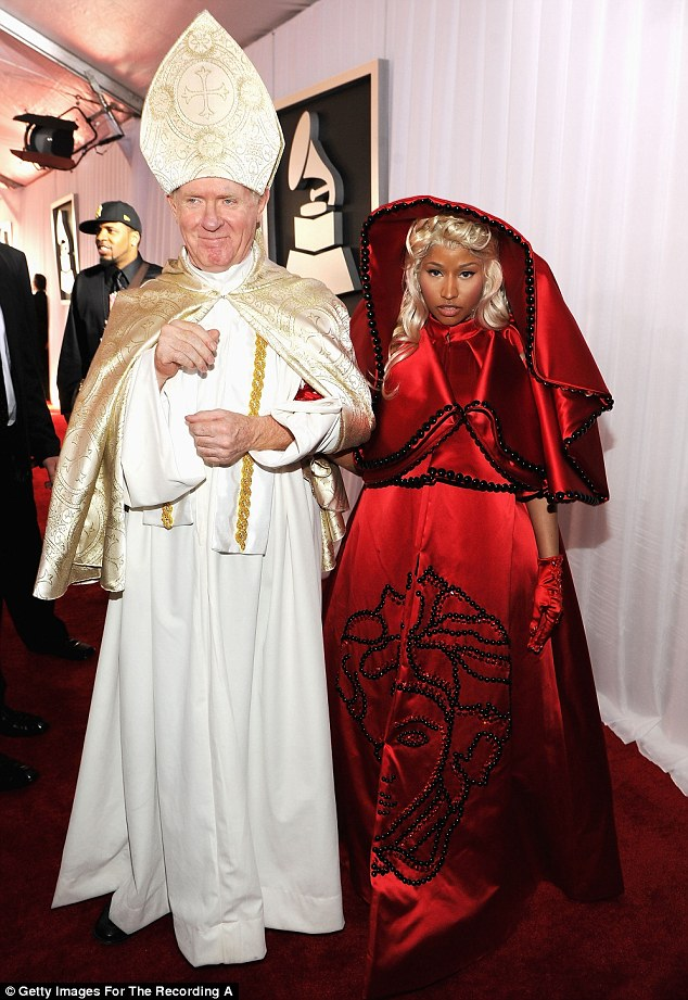 Dressed up: Minaj walked the red carpet with a man dressed up as the Pope
