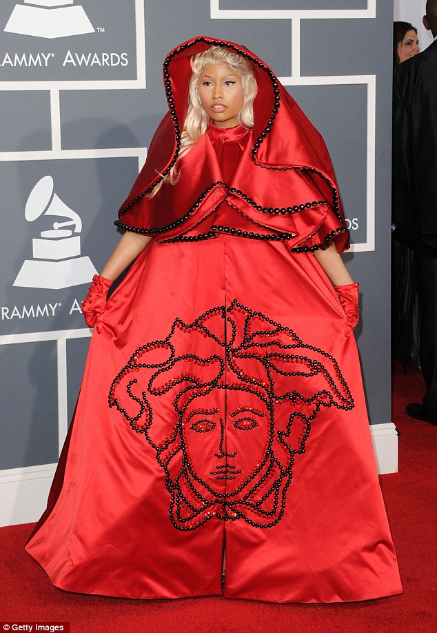 Controversial: Rapper arrived on the red carpet in Los Angeles last night in a scarlet red Versace creation
