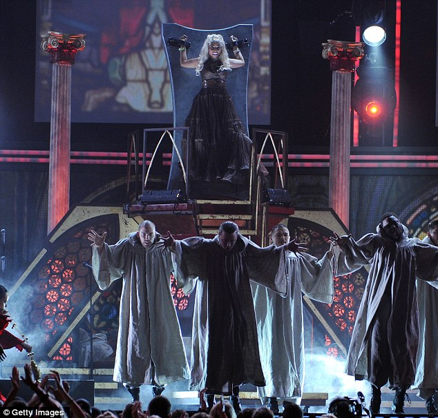 Religious connotations: Nicki performed against the backdrop of a stained-glass window church, with her dancers dressed in robes
