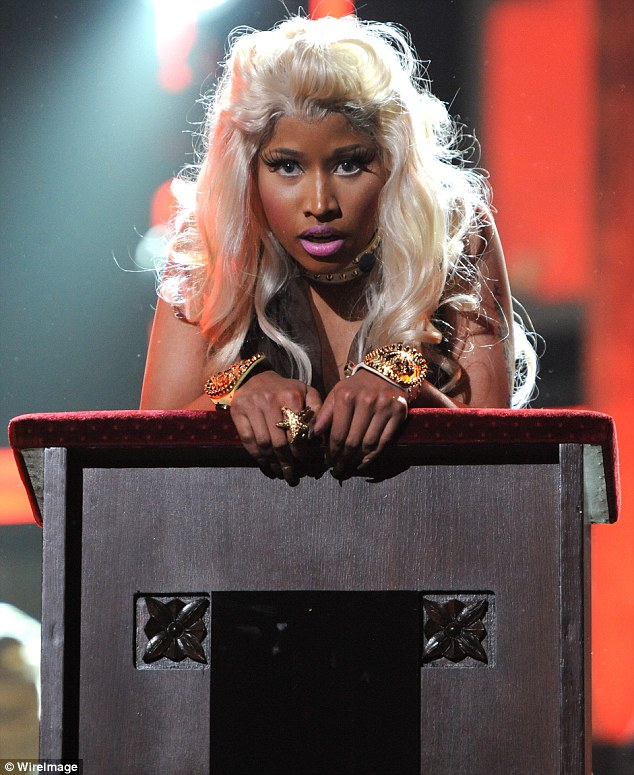 Prayer: Minaj continued the church theme that she began outside by holding on to a pulpit, almost bowing her head in prayer