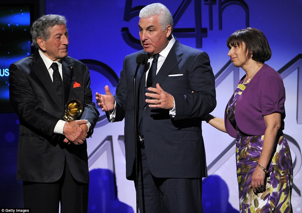 Tribute: Amy Winehouse's parents Mitch and Janis accept the award for Best Pop Dup/Group performance, along with Tony Bennett, on behalf of their late daughter