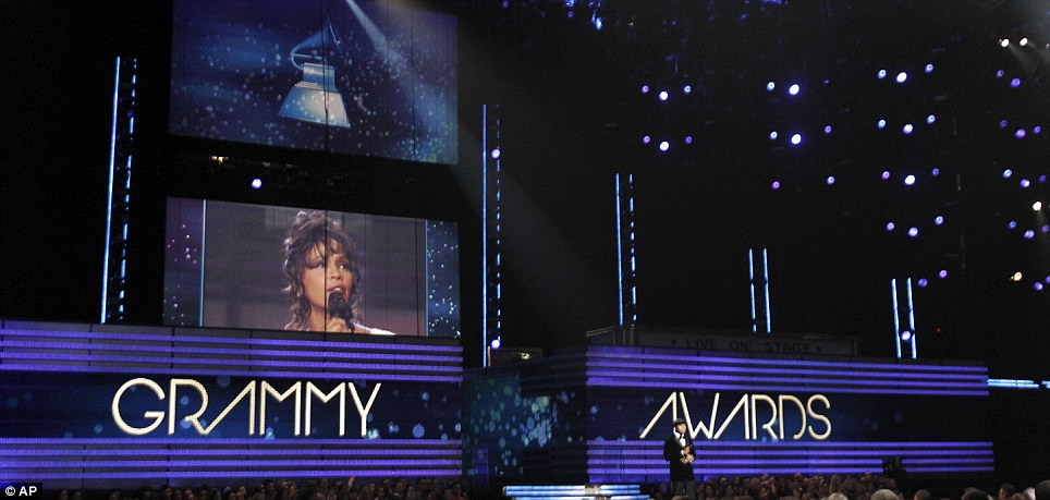 Tribute: Host LL Cool J led the audience in prayer at the Staples Center as the star-studded crowd paused to remember Whitney Houston