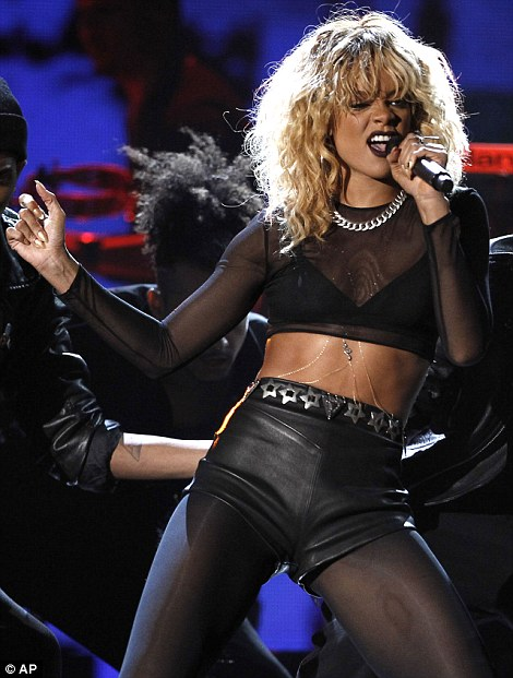 Racy: Rihanna gave a steamy performance at the Grammy Awards two years after a violent altercation with then boyfriend Chris Brown forced her to pull out of a planned performance