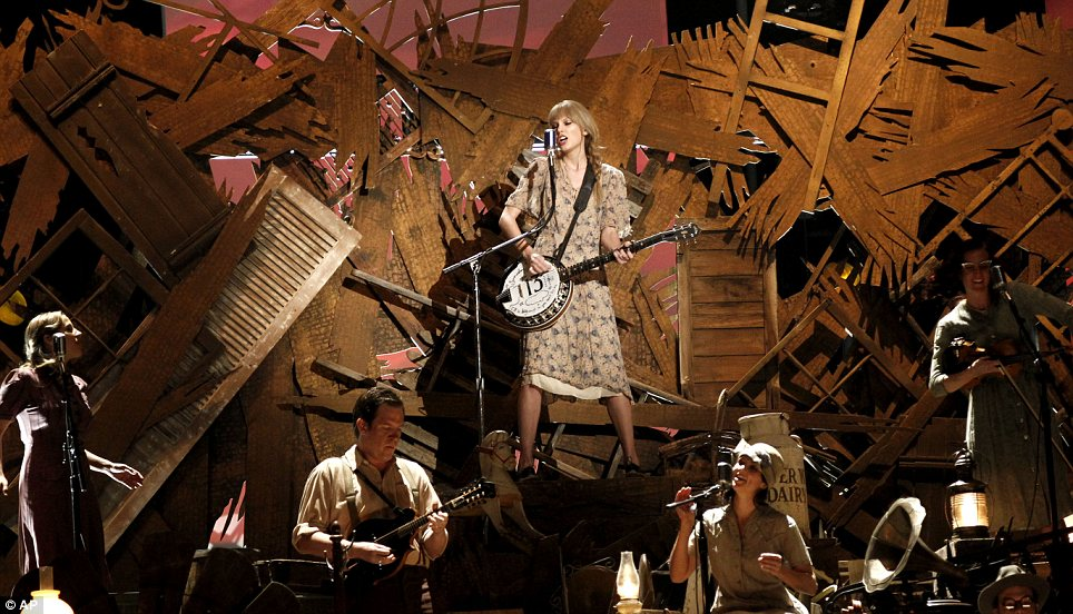 Country girl: Taylor Swift performed with her band armed with a banjo