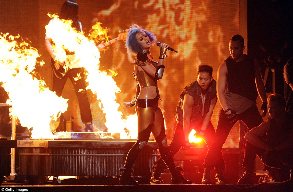 Firework: Katy Perry took to the stage in a form-fitting outfit, performing against a background of dramatic pyrotechnics