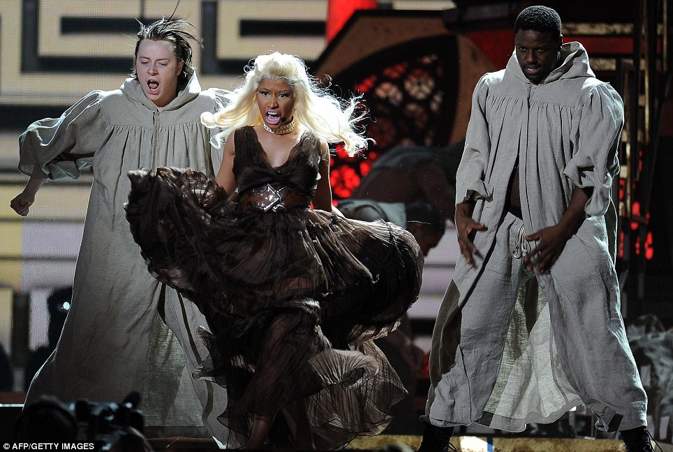 Commanding the audience: Nicki Minaj delivered a dramatic performance of her upcoming single Roman Holiday after arriving at the bash with a man dressed as the Pope
