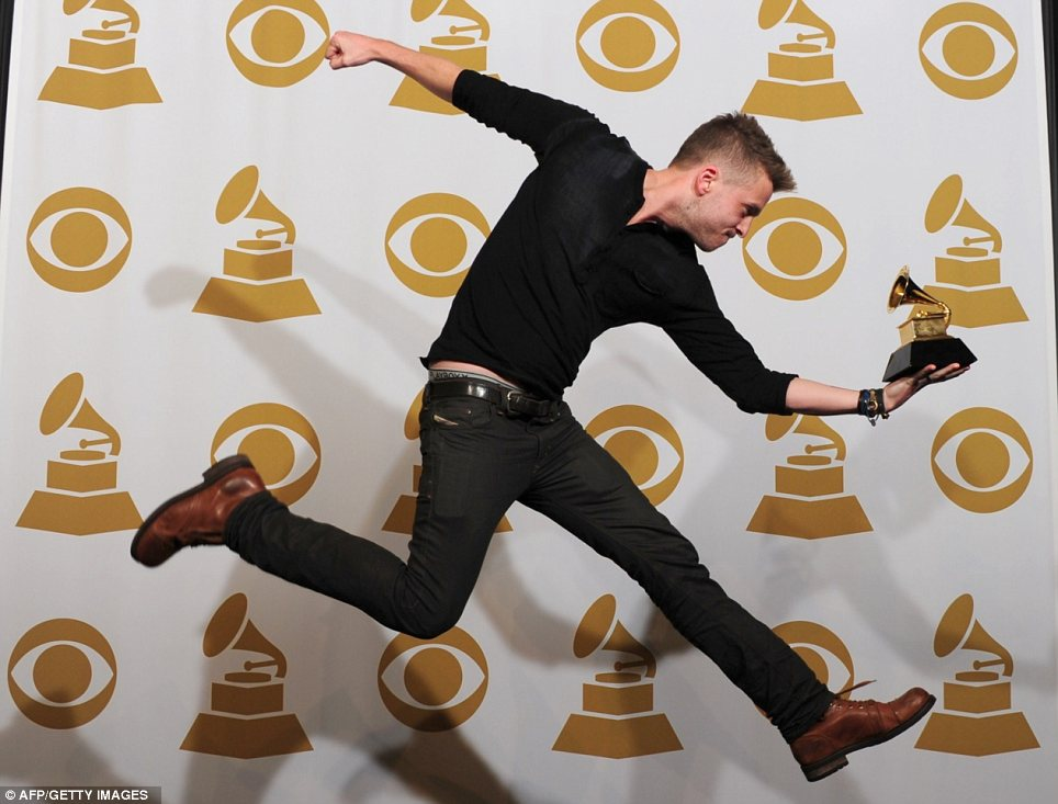 Something to celebrate: Ryan Tedder, who produced Adele's award-winning album 21, was literally jumping with joy after scooping the gong
