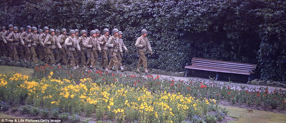 Vivid: The full-colour photographs show American forces in the days leading up to the historic Normandy invasion, nearly 70 years ago