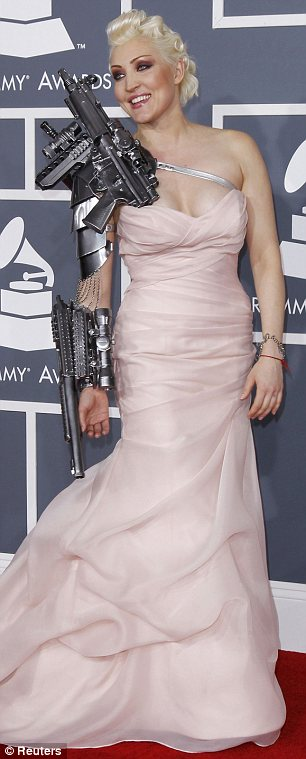 Pale and, erm, interesting: Singer Sasha Gradiva was perhaps trying to boost her profile with this bionic outfit (left)