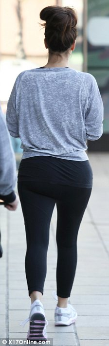 Work out wear: Kim teamed the themed top with some gym leggings and trainers in colours that matched her T-shirt