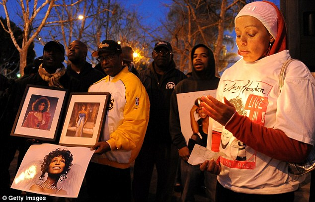 Grieving: Mourners at a vigil for Whitney Houston in Leimert Park in Los Angeles