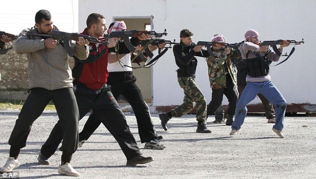 Training: Syrian rebels rehearse their moves which they continue to use against Assad's forces