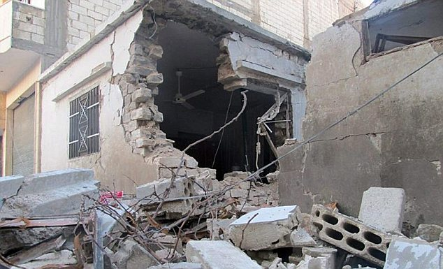 Destruction: A house in Homs has been left as rubble after being shelled by Syrian forces