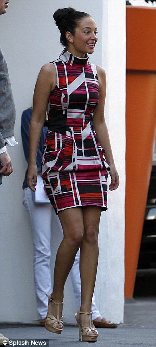 La makeover: Tulisa showed off her tan as she left her hotel today in a bright graphic dress