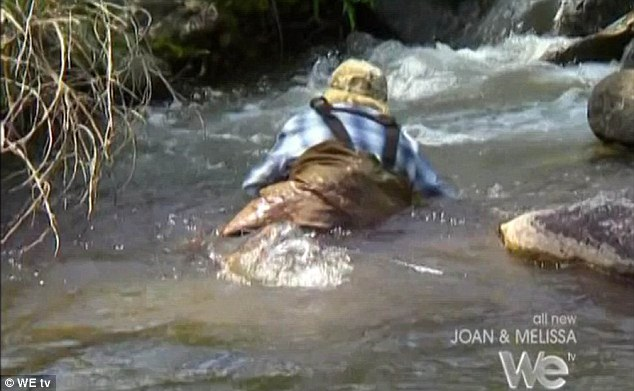 Splash: Joan Rivers falls face first into a river on a camping trip to Wyoming on tonight's episode of reality show Joan and Melissa: Joan Knows Best