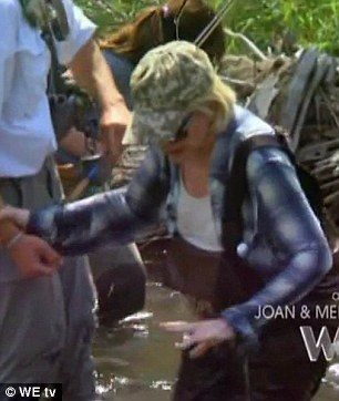 Oops! Joan splashes around in the water and is offered a helping hand after getting her soaking