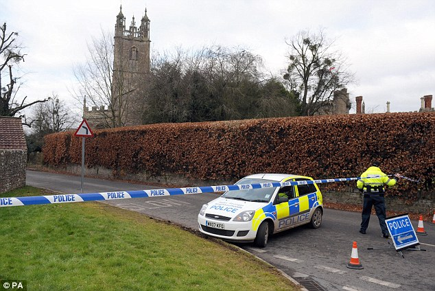 Police attend the scene outside the vicarage next to St Mary's church, where the vicar's body was found by builders