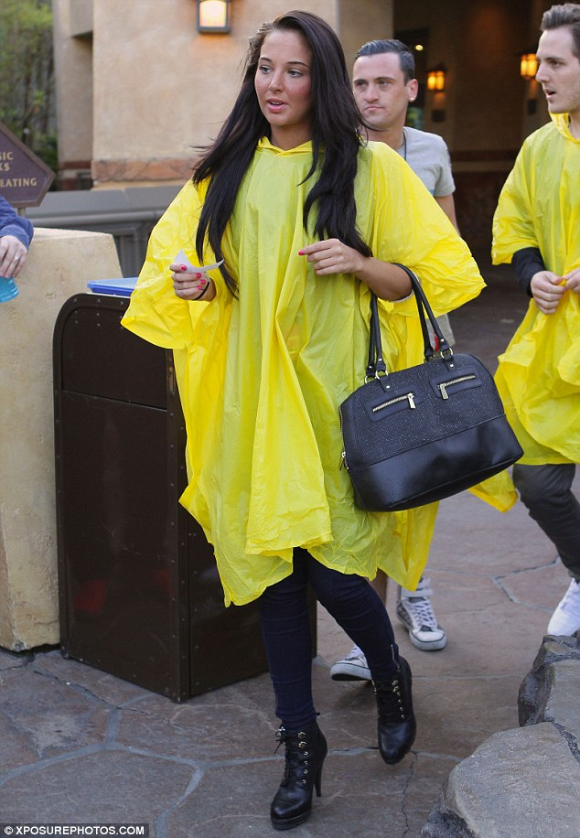 No vanity: Tulisa wasn't fussed about walking around in her big yellow poncho