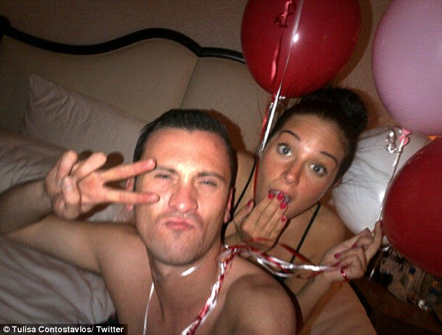 Trying to make a point? Tulisa Contostavlos posed for snaps with her PA Gareth Varey on Valentine's Day in LA