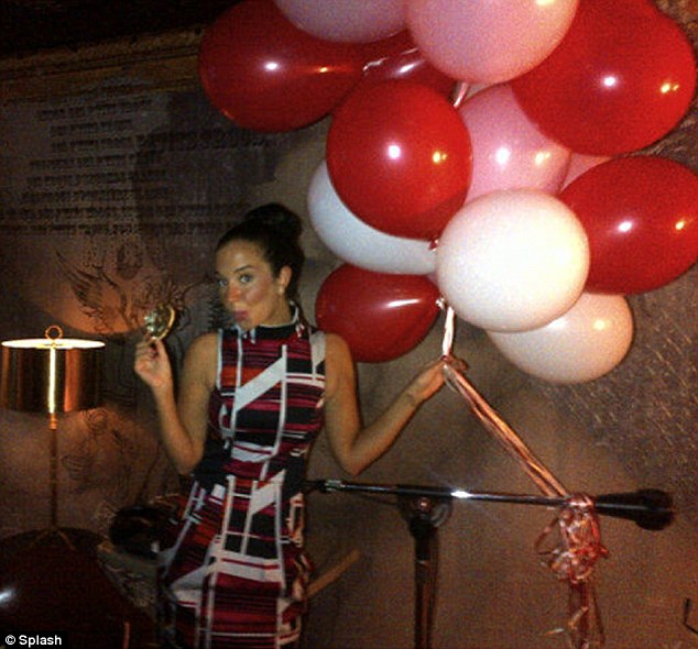 Endless entertainment: Tulisa showed off a huge bunch of red, pink and white Valentine's balloons