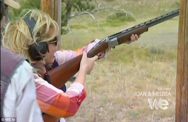 Crack shot: Joan seemed to be having more of a good time when she took part in a family session of skeet shooting