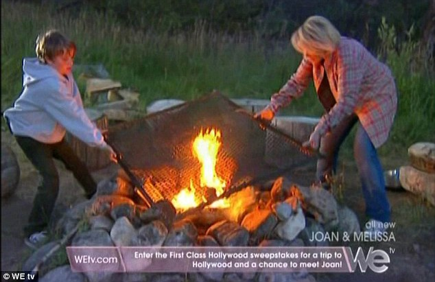 Fanning the flames: Joan and Cooper made an attempt to get the campfire going after pitching the tent