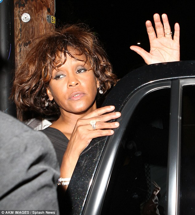 The last photos: Whitney Houston was said to have had a premonition in the days before her death. Reports claim she quoted the bible and spoke of 'wanting to see Jesus'.  Seen here two days before she died