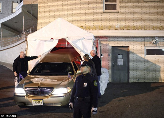 Goodbye: The hearse backs up to the funeral home and the body of Whitney Houston is entered into the building