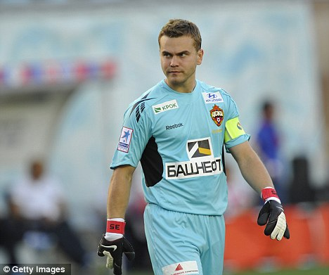 Target: Russian goalkeeper Igor Akinfeev is attracting interest from Chelsea