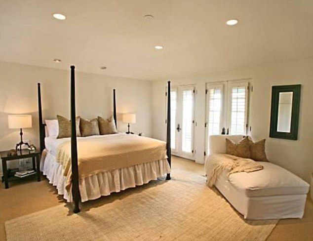 Living like a king: Master bedroom features a four poster bed