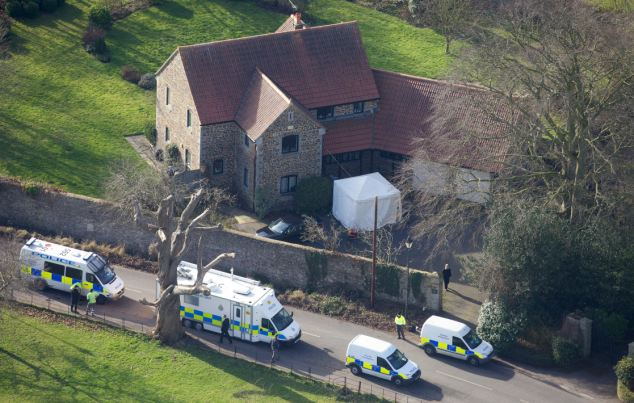 Police continued their inquiries outside the vicarage where Rev Suddard's body was found