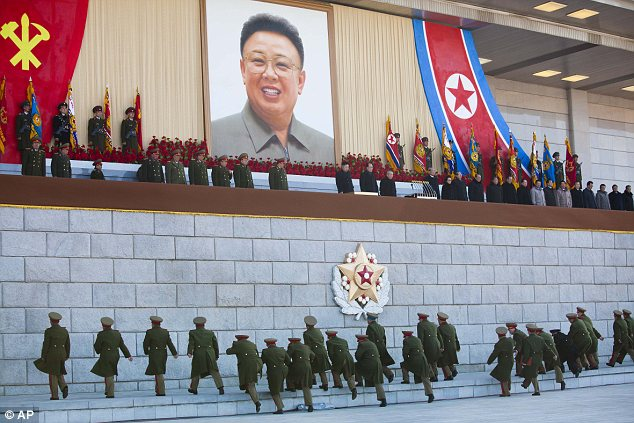Scramble: Senior North Korean military members pictured approaching an area where new North Korean leader Kim Jong Un and other military and political leaders were standing