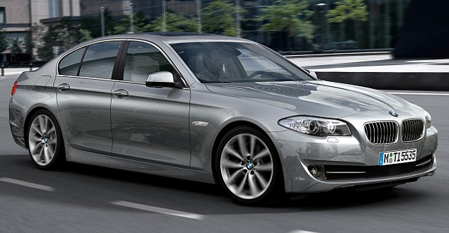 Easier on the wallet: The BMW 5-Series, which costs £28,000 to buy and a further £21,000 to run for three years, was named the best-value executive car